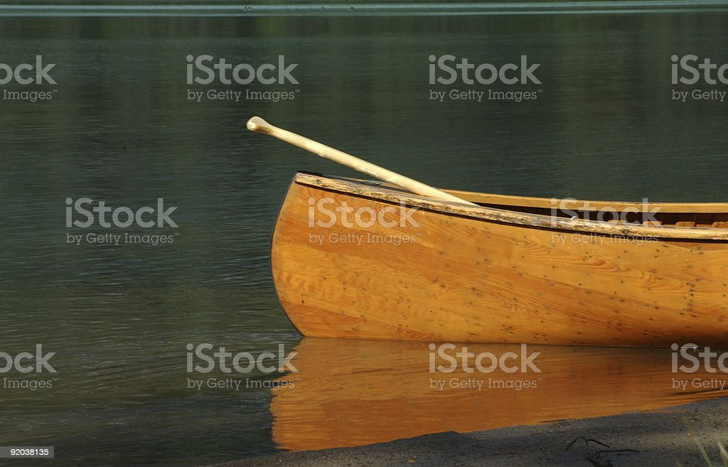 A canoe reflected on the surface of the water royalty-free stock photo