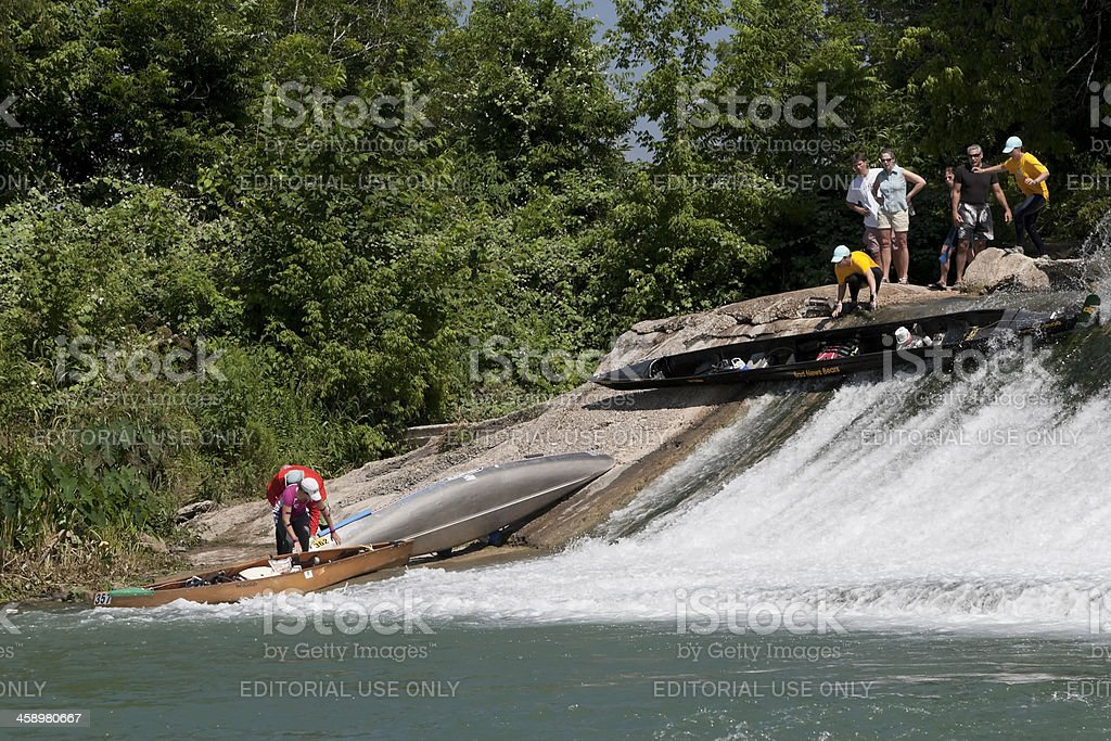 Canoe sliding down the dam. royalty-free stock photo