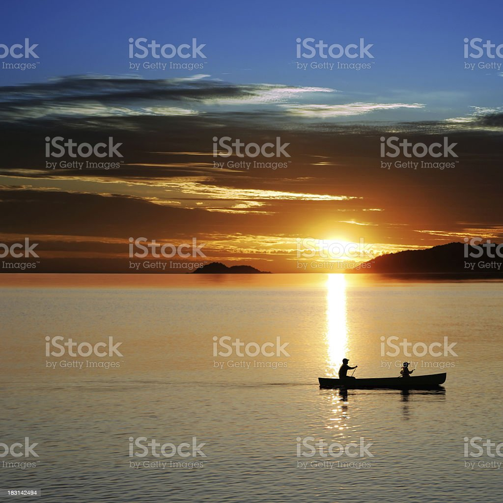 XL canoe sunset stock photo