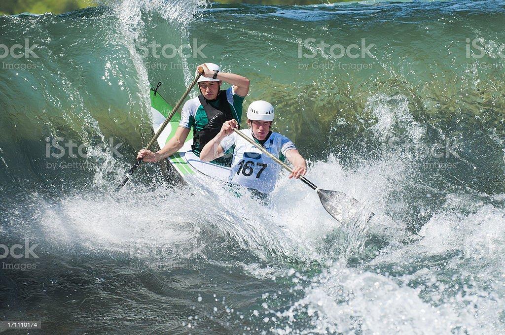 Canoe team on whitewater royalty-free stock photo