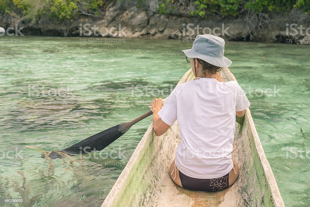 Canoeing among the Togian Islands stock photo