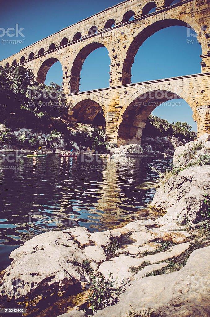 Canoeing below Aqueduct Pont du Gard stock photo