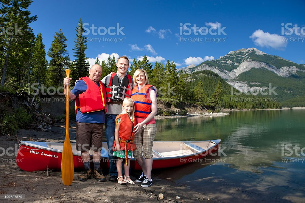 Canoeing Family in the Great Outdoors royalty-free stock photo