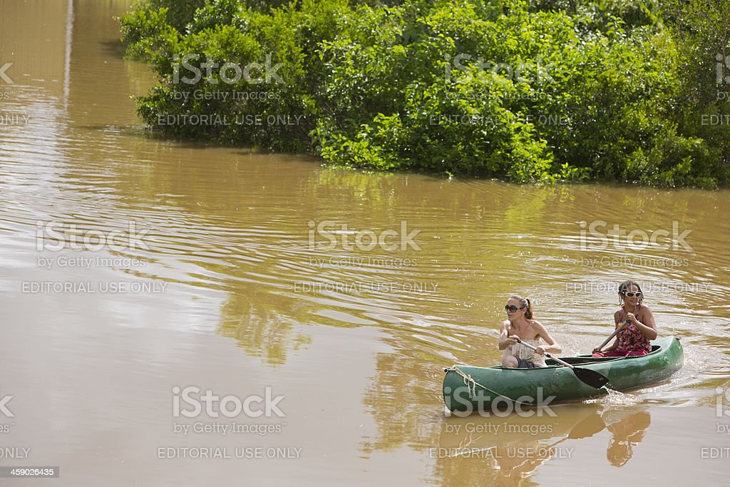 Canoeing in Flood Water royalty-free stock photo