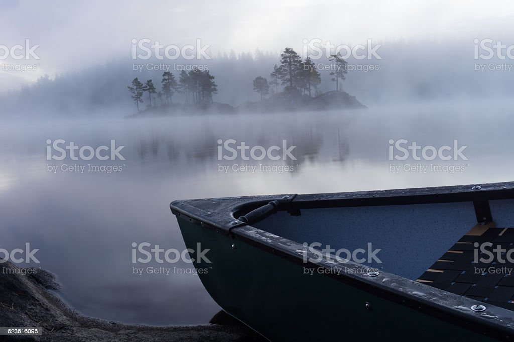 Canoeing in the misty forest in Norway stock photo
