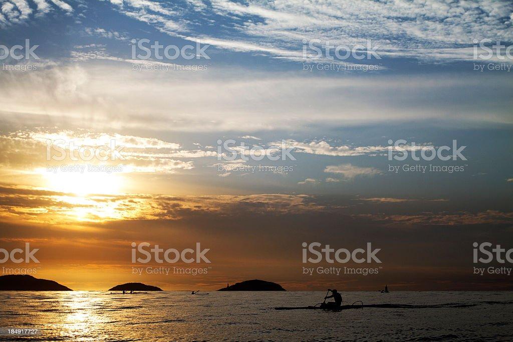 Canoeing in the sunrise stock photo