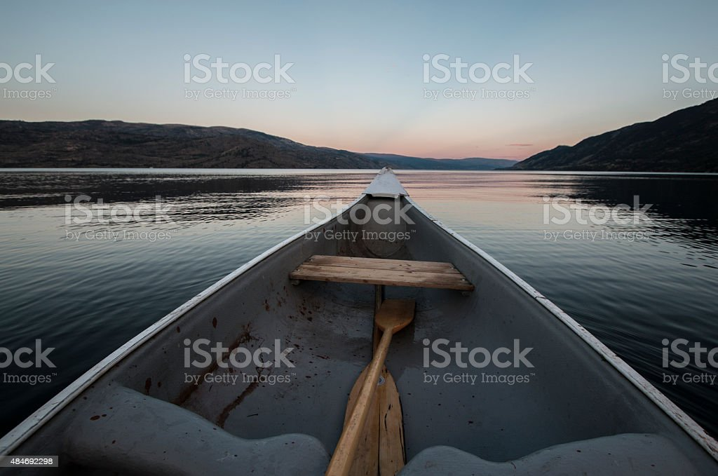 Canoeing into the sunset stock photo