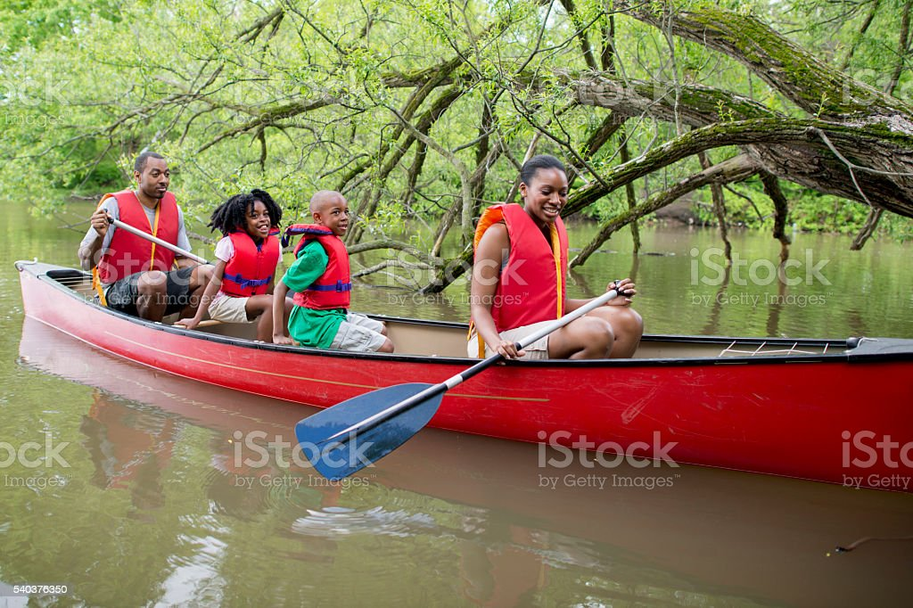 Canoeing on a Lake in Canada stock photo
