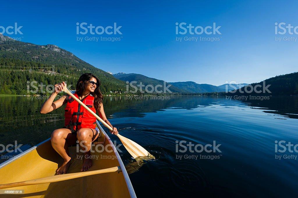 Canoeing on a prisitine mountain lake stock photo