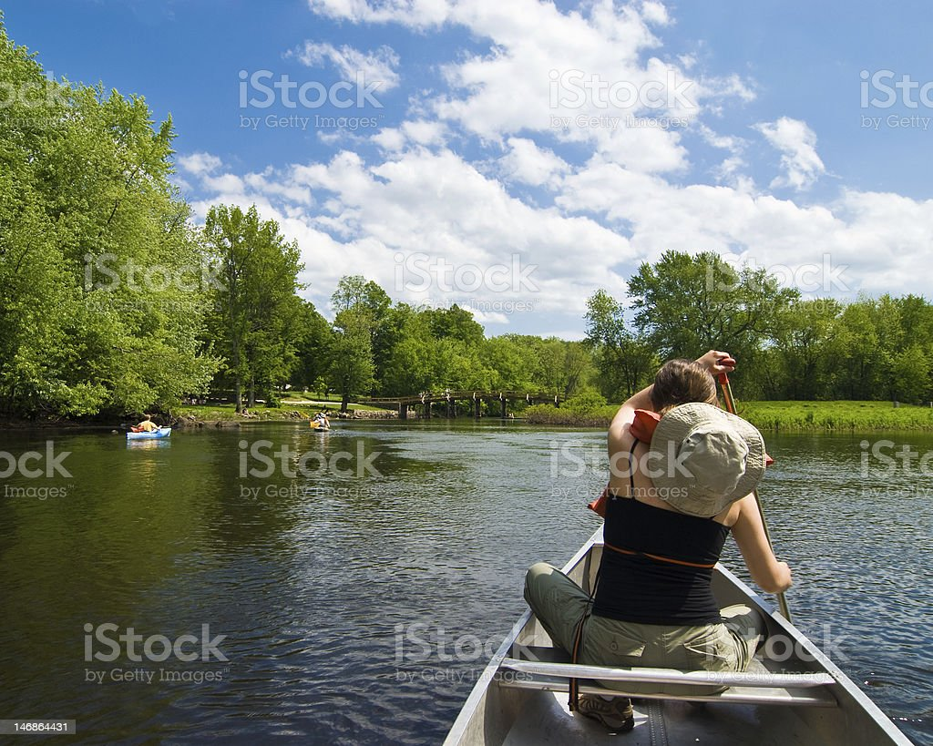 Canoeing on a small river stock photo