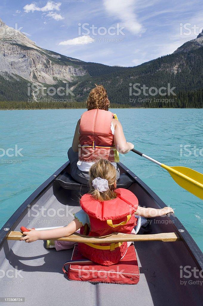 Canoeing on Mountain Lake. royalty-free stock photo