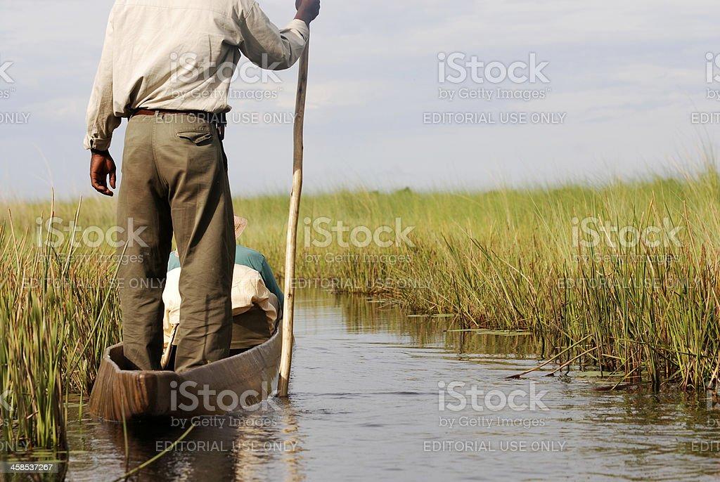 Canoeing on the Okavango Delta in Botswana royalty-free stock photo