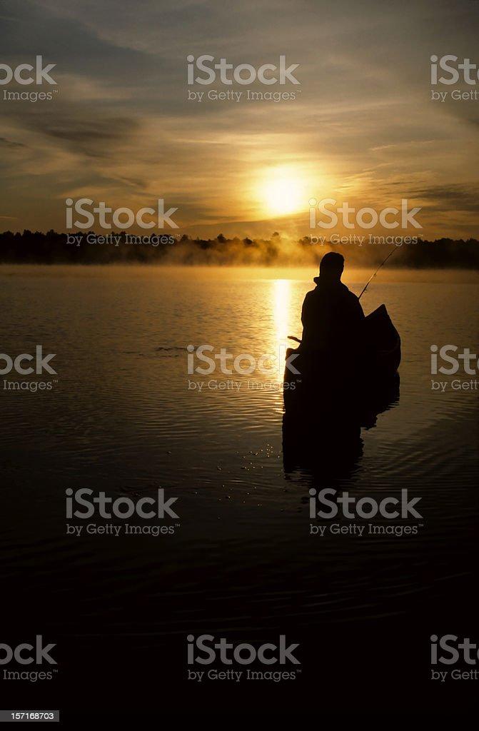 canoeing through morning fog royalty-free stock photo