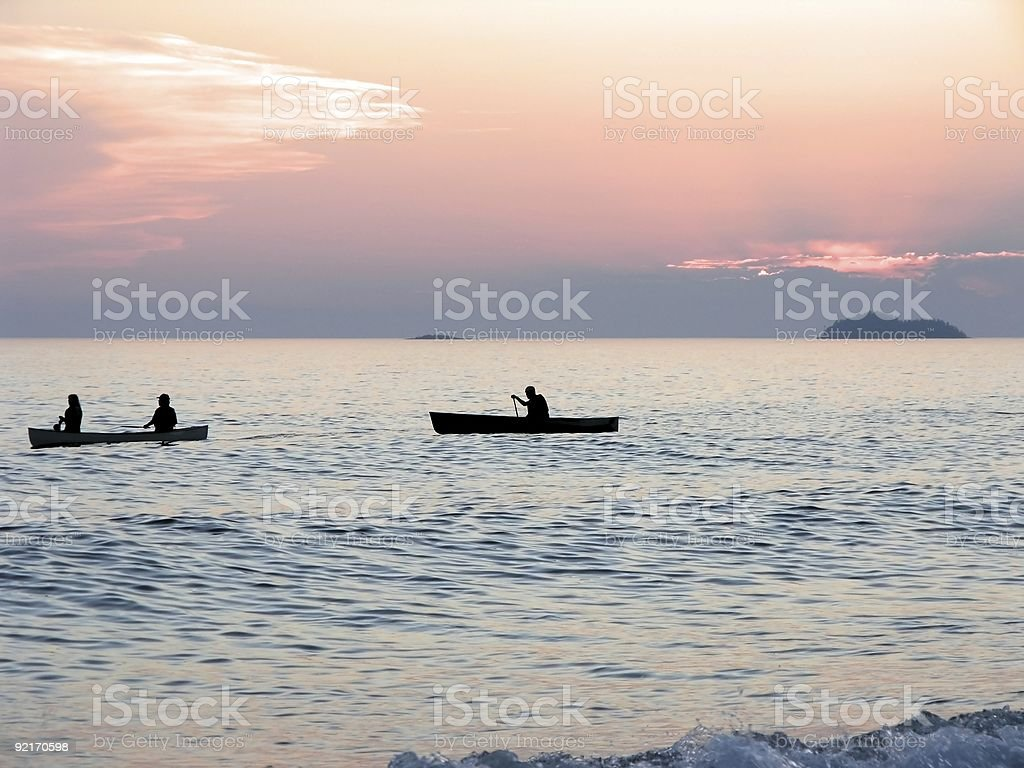 Canoeists at Sunset royalty-free stock photo