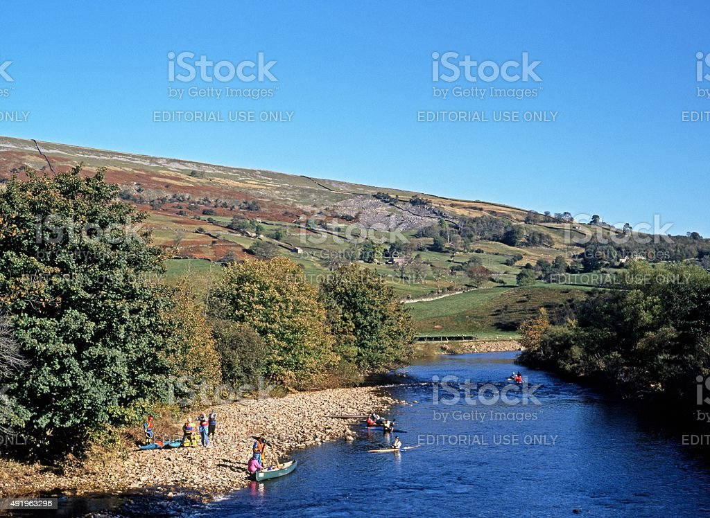 Canoeists on the River Swale, Grinton. stock photo