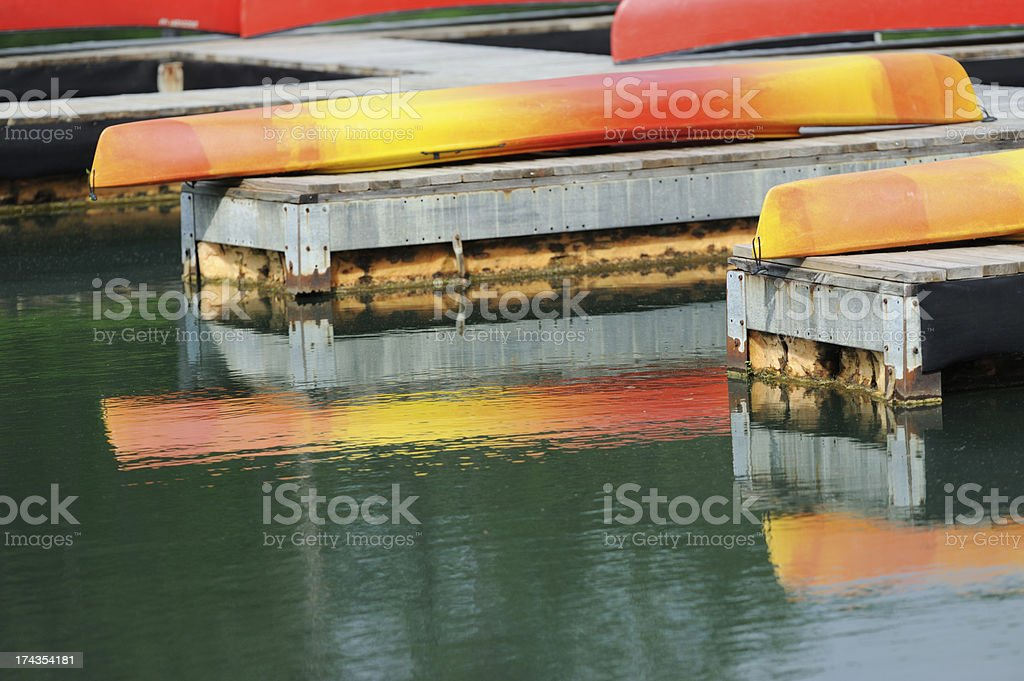 Canoes and kayaks on pier royalty-free stock photo