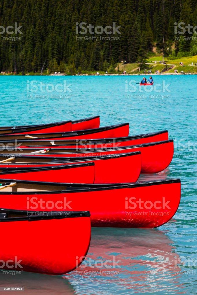 Canoes at Lake Louise, Banff National Park, Canada stock photo