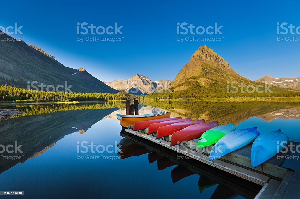 Canoes at Many Glacier Swiftcurrent Lake Glacier National Park stock photo