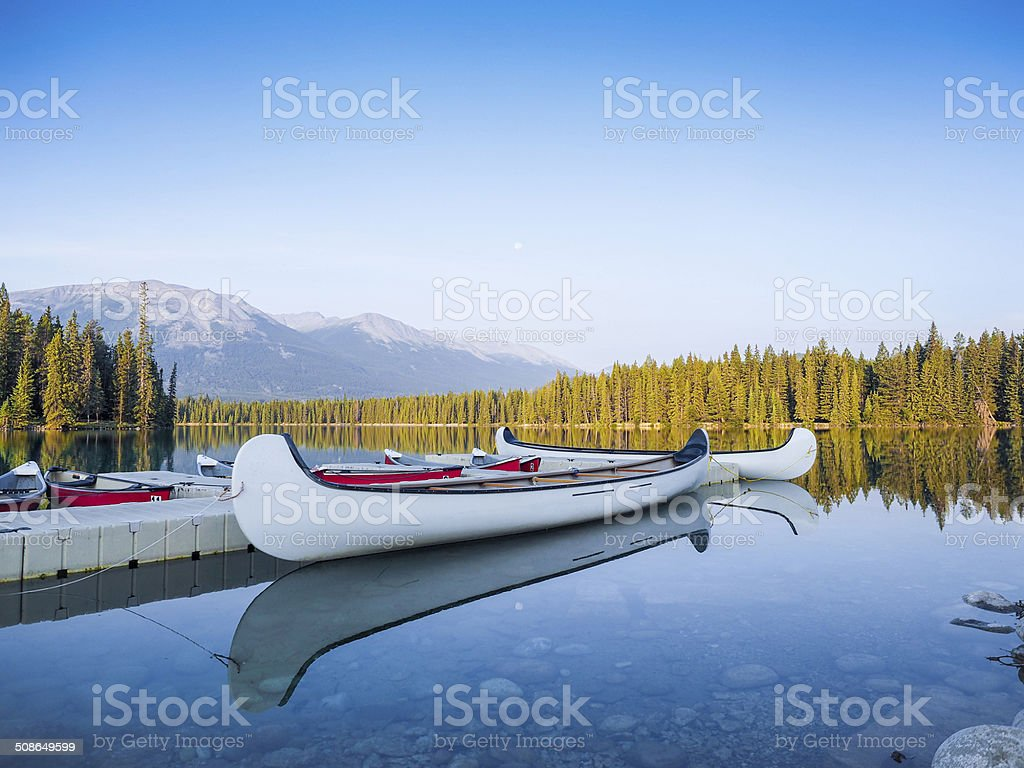 Canoes at Mountain Lake-Tranquil Scene stock photo