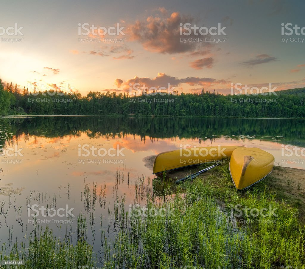Canoes at sunset HDR royalty-free stock photo