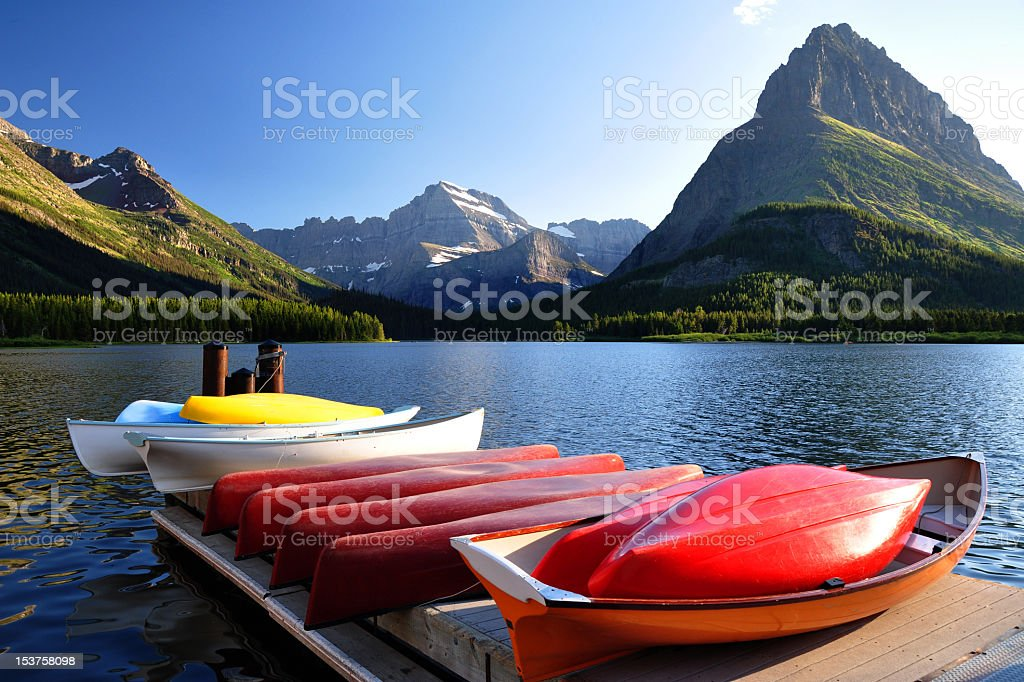 Canoes at Swiftcurrent Lake, Many Glacier Hotel, Montana royalty-free stock photo