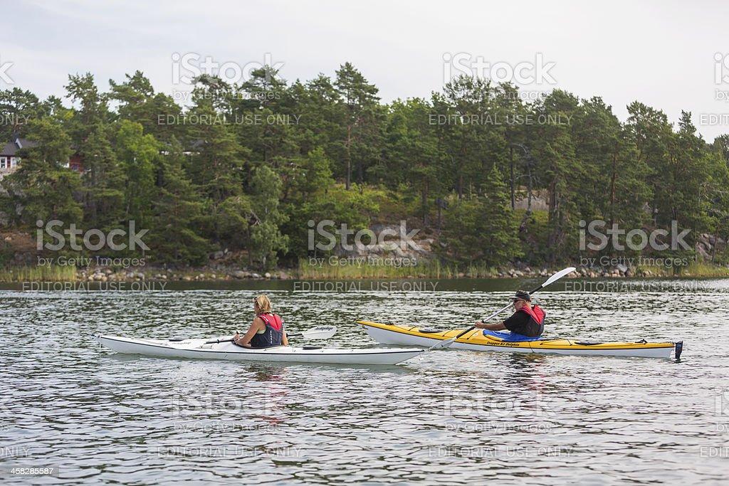 Canoes in Stockholm Archipelago, Sweden royalty-free stock photo