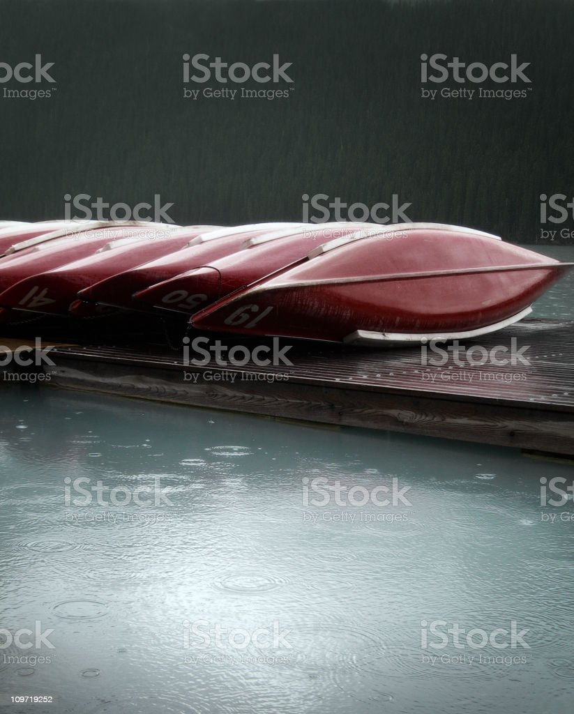 Canoes in the rain royalty-free stock photo