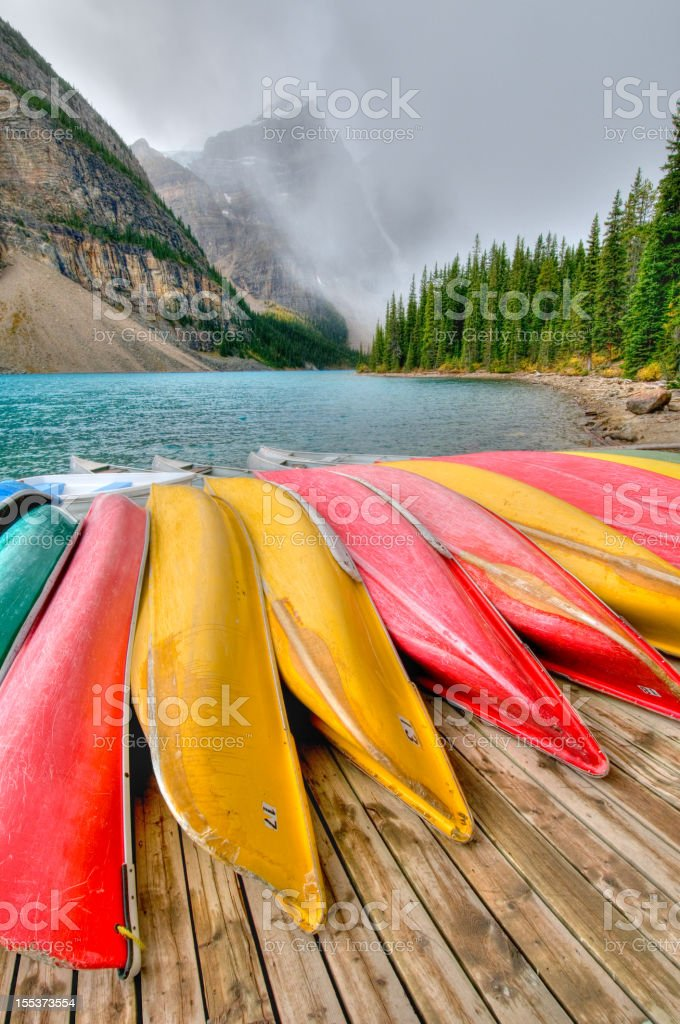 Canoes line dock at Moraine Lake, Banff National Park stock photo