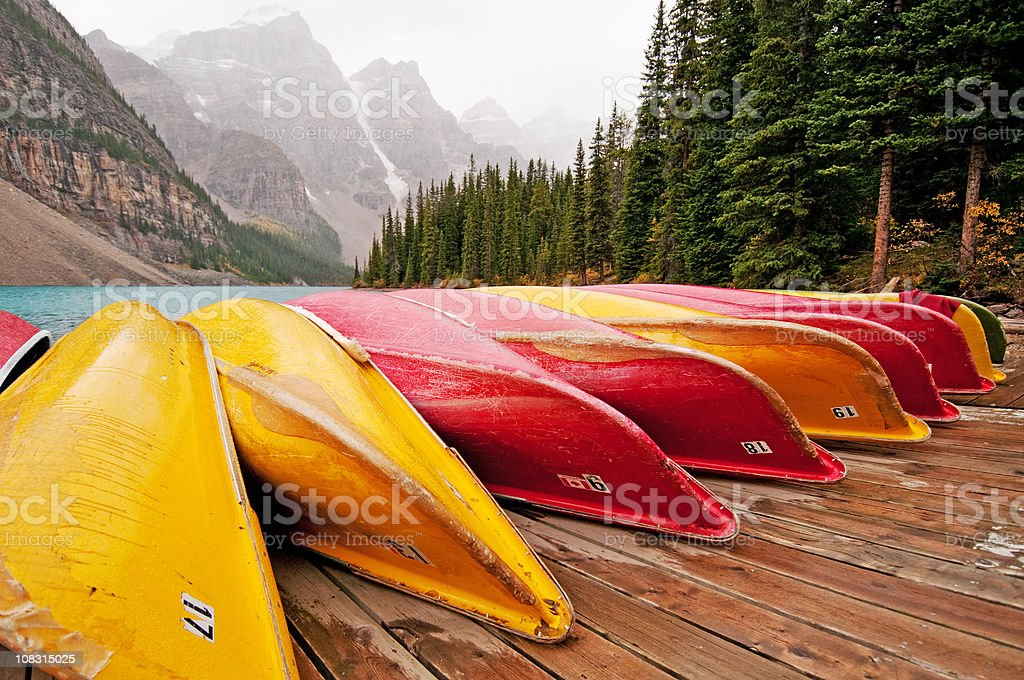 Canoes line the dock at Moraine Lake, Banff royalty-free stock photo