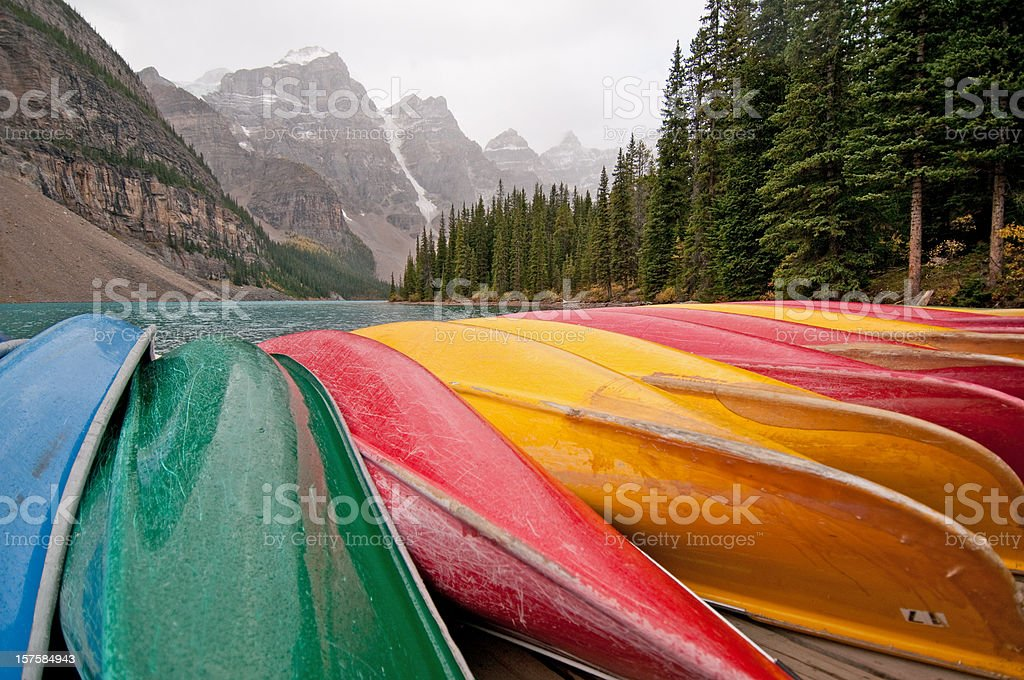 Canoes line the dock at Moraine Lake, Banff stock photo
