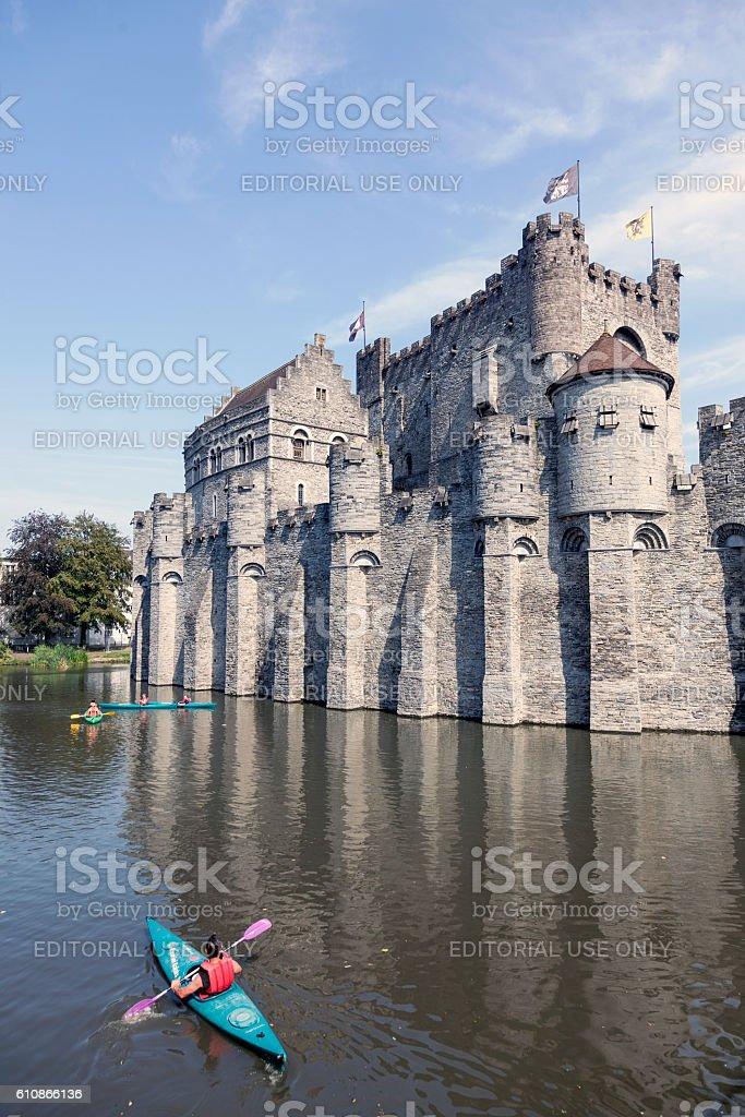 canoes near castle gravensteen in belgium city of ghent stock photo