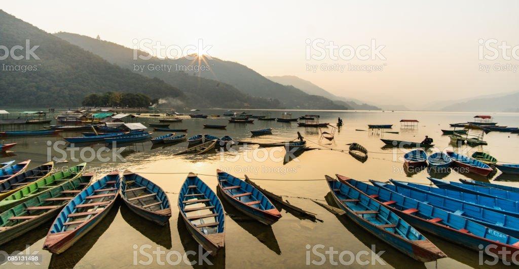 Canoes on lake stock photo