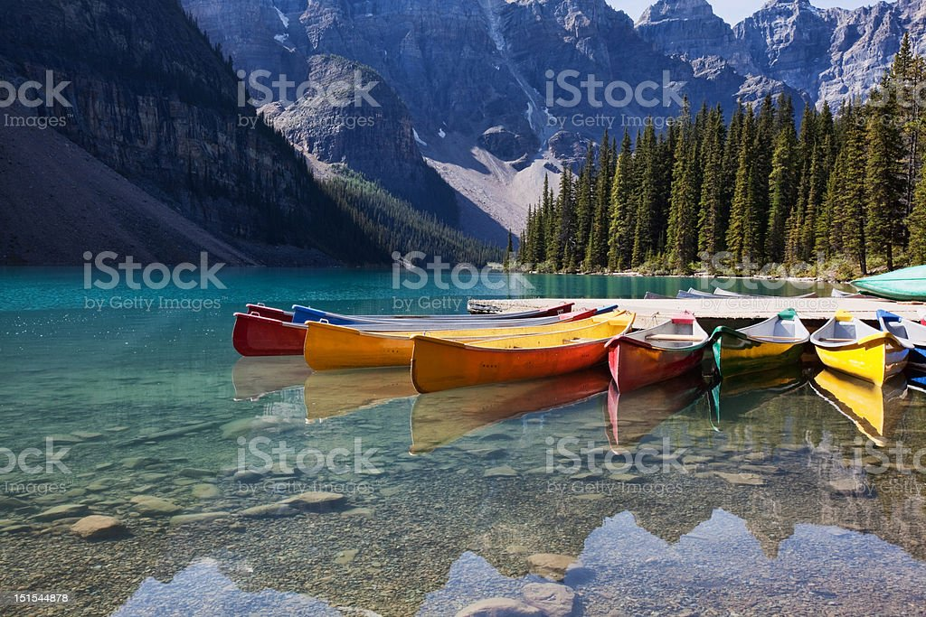Canoes on Moraine Lake stock photo