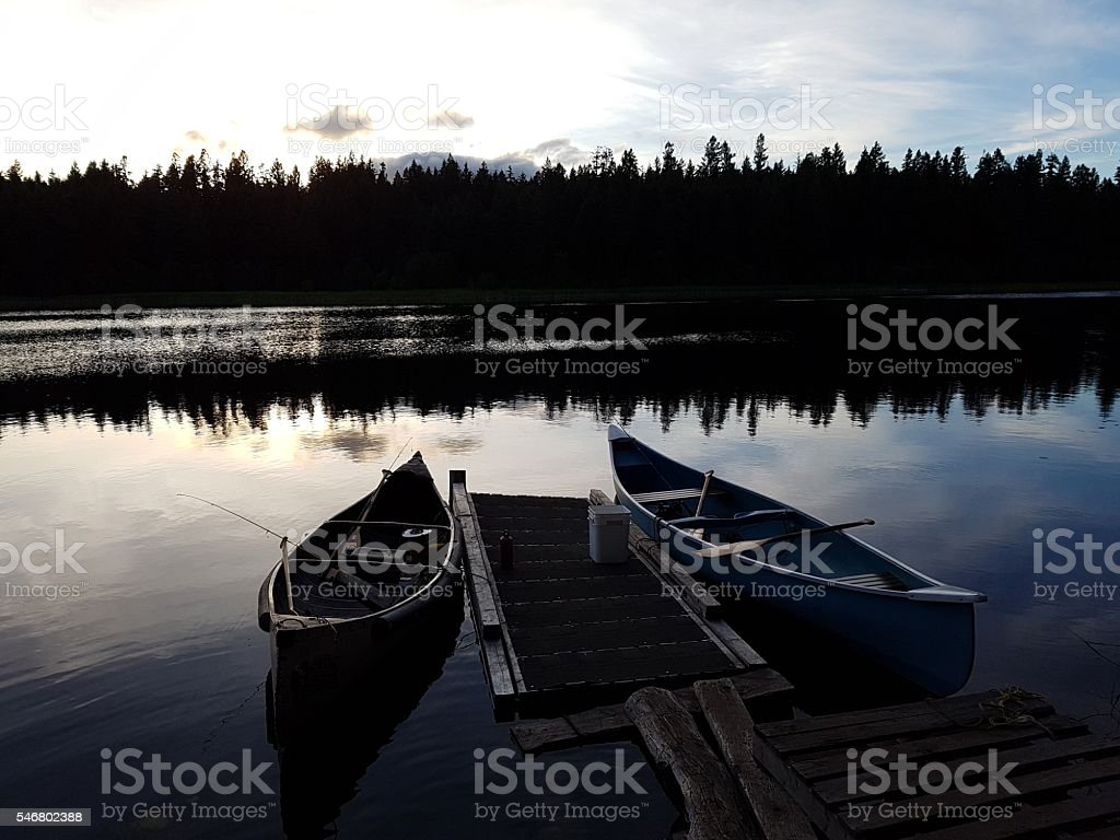 Canoes on the dock stock photo
