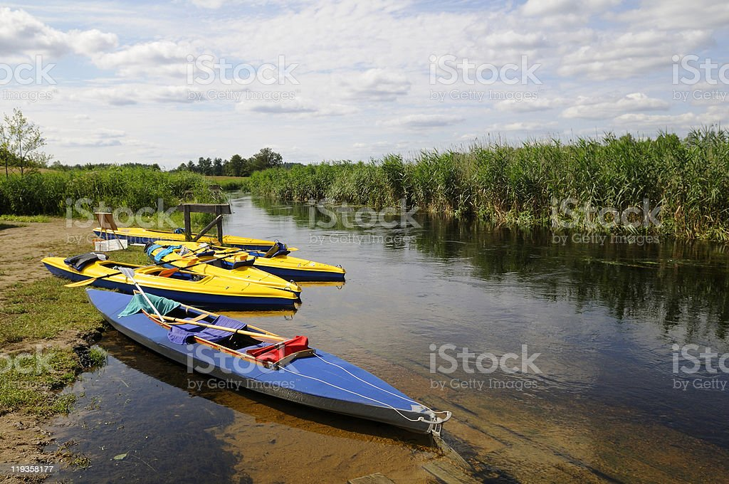 canoes on the riverbank stock photo