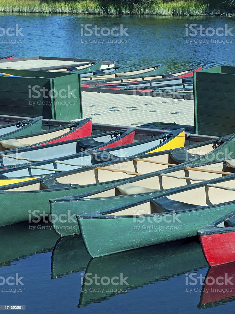 Canoes tied to dock at marina on river in Oregon royalty-free stock photo