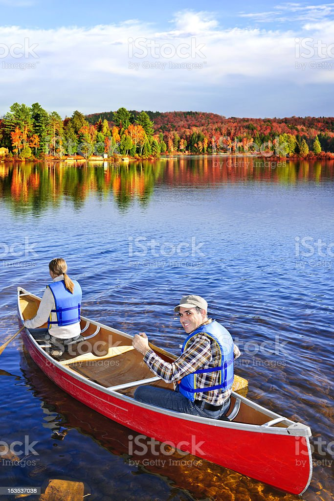 Canoing in fall stock photo