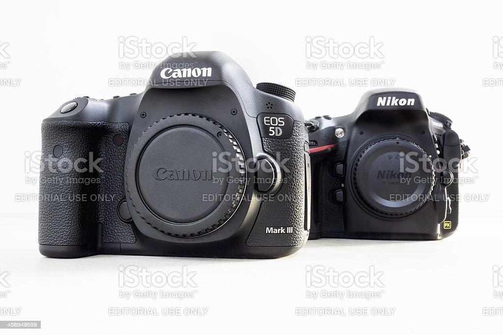 Canon 5D Mark III vs. Nikon D800 Digital SLR stock photo