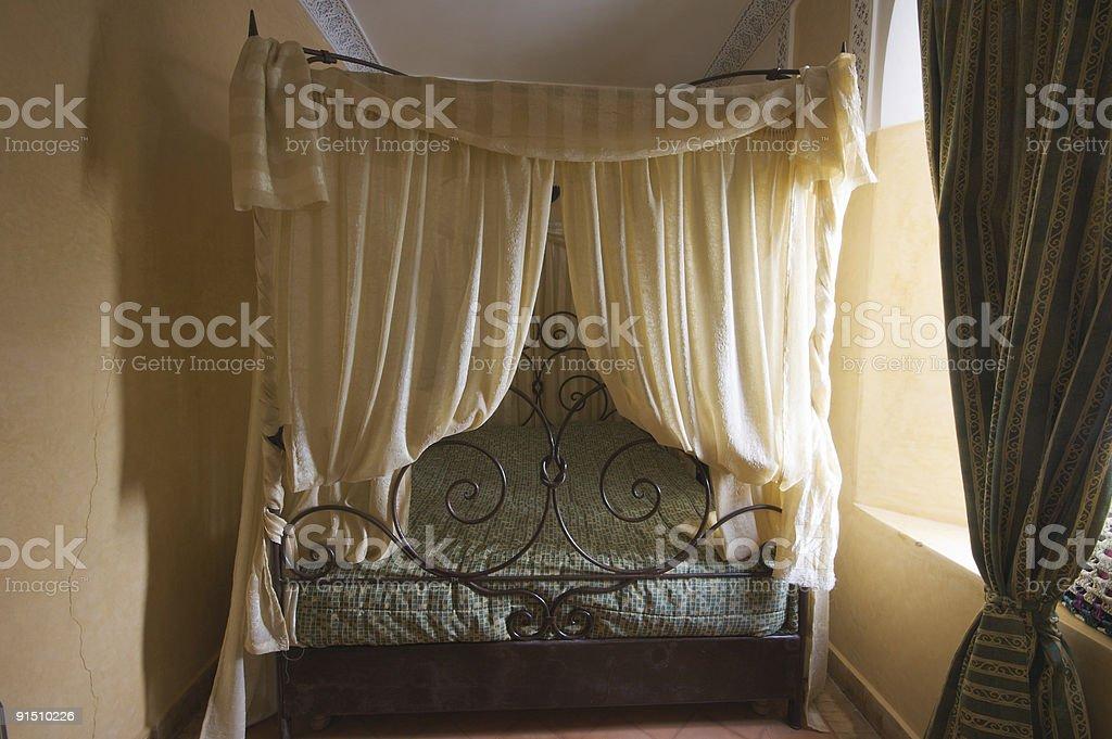 Canopy bed in a Marrakesh medina riad stock photo