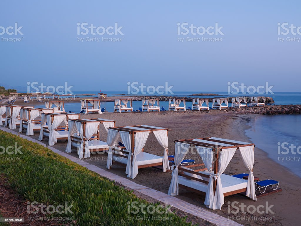 Canopy Beds and Sun Chairs - Sunset at the Beach stock photo