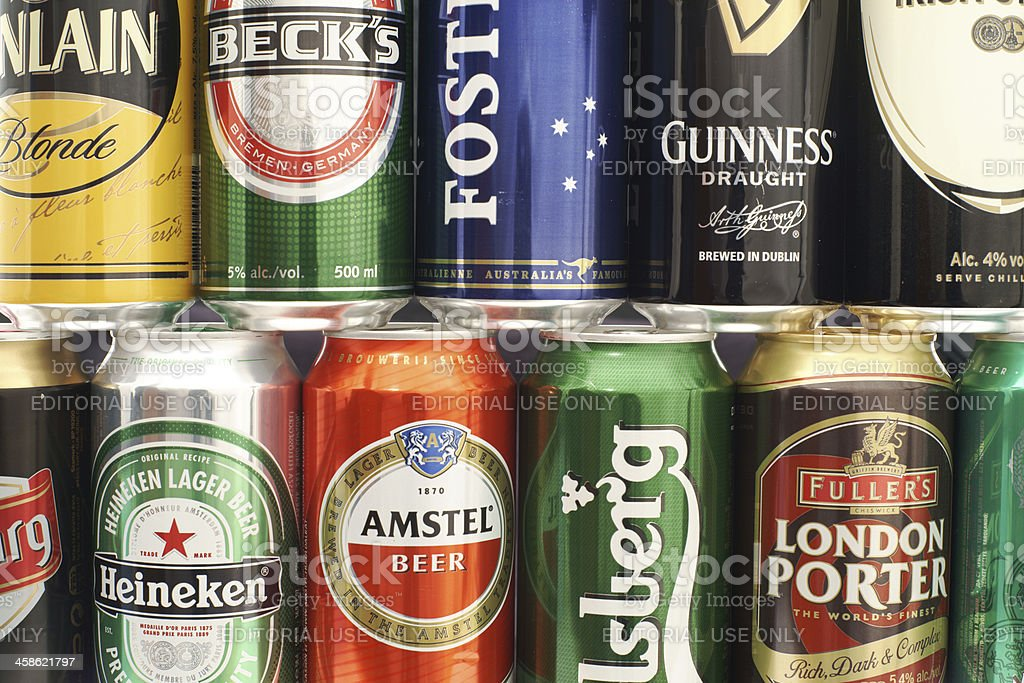 Cans of beer as wallpaper stock photo