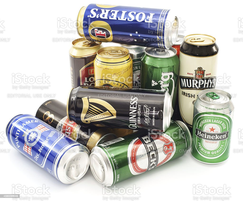 Cans of beer pile isolated on white stock photo