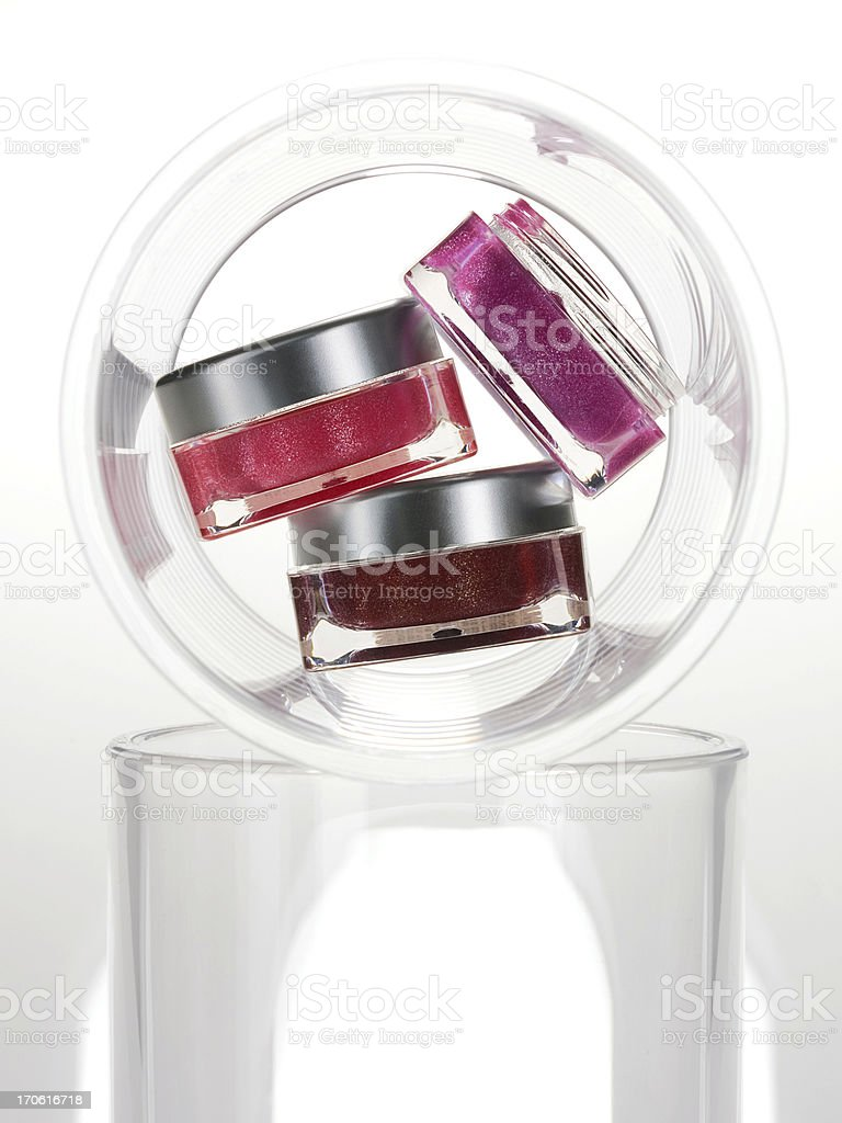 Cans of lip cream/moisturizer royalty-free stock photo