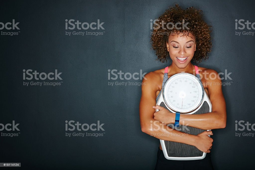 I can't believe that I'm finally at my goal weight stock photo