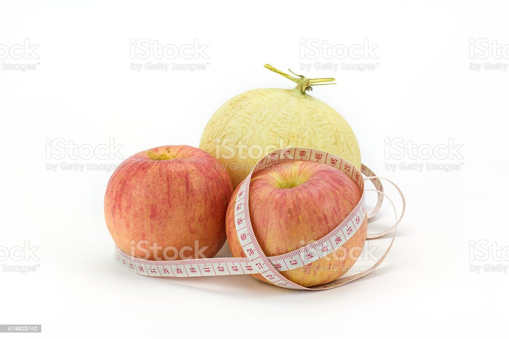 cantaloupe and apple isolated on white,focus on apple royalty-free stock photo