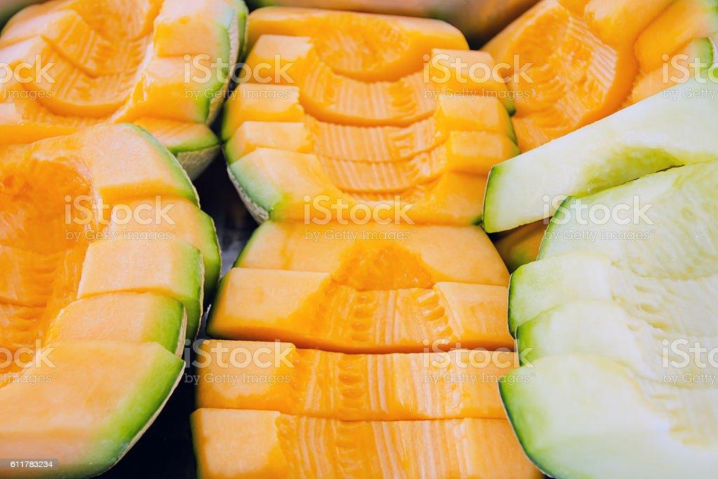 Cantaloupe or Charentais melon sliced background stock photo