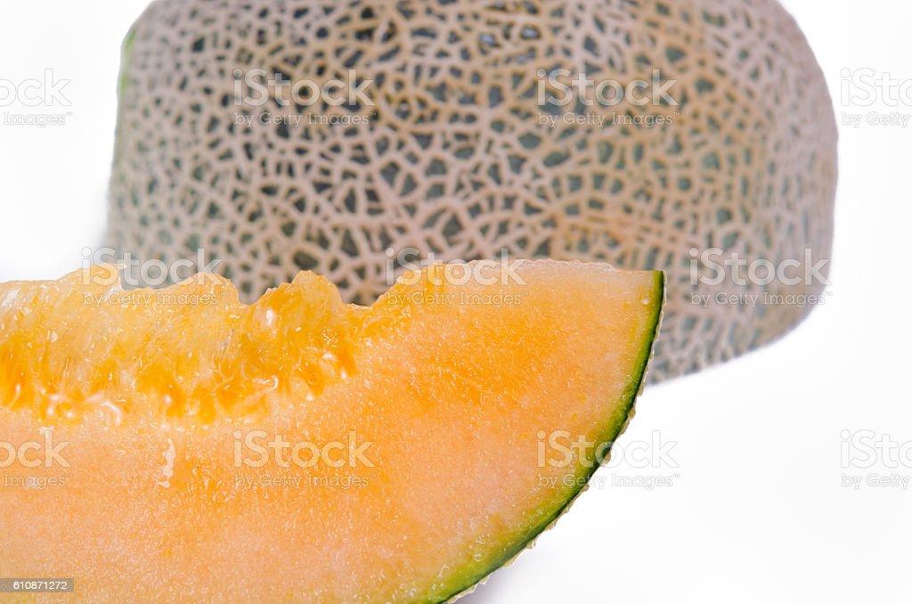 Cantaloupe or Charentais melon sliced on white background stock photo