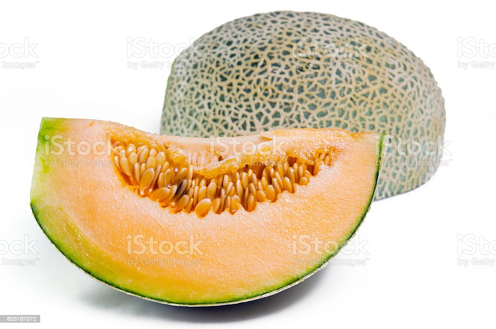 Cantaloupe or Charentais melon with half and seeds on white stock photo