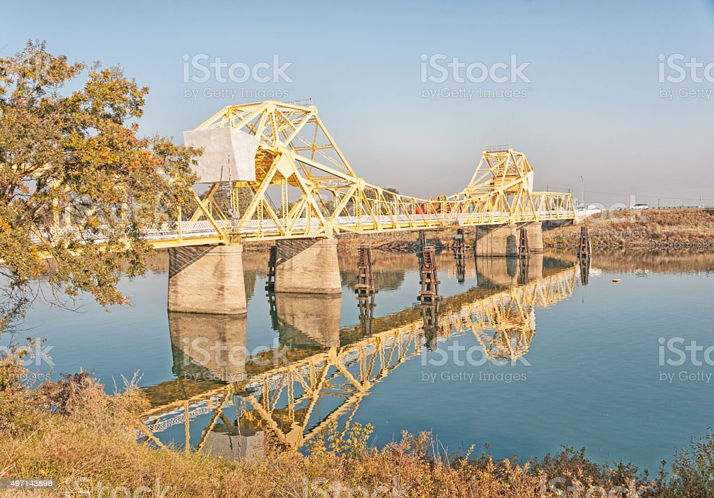 Cantiliver Bridge over Sacramento River with Construction Equipment and Vehicles stock photo