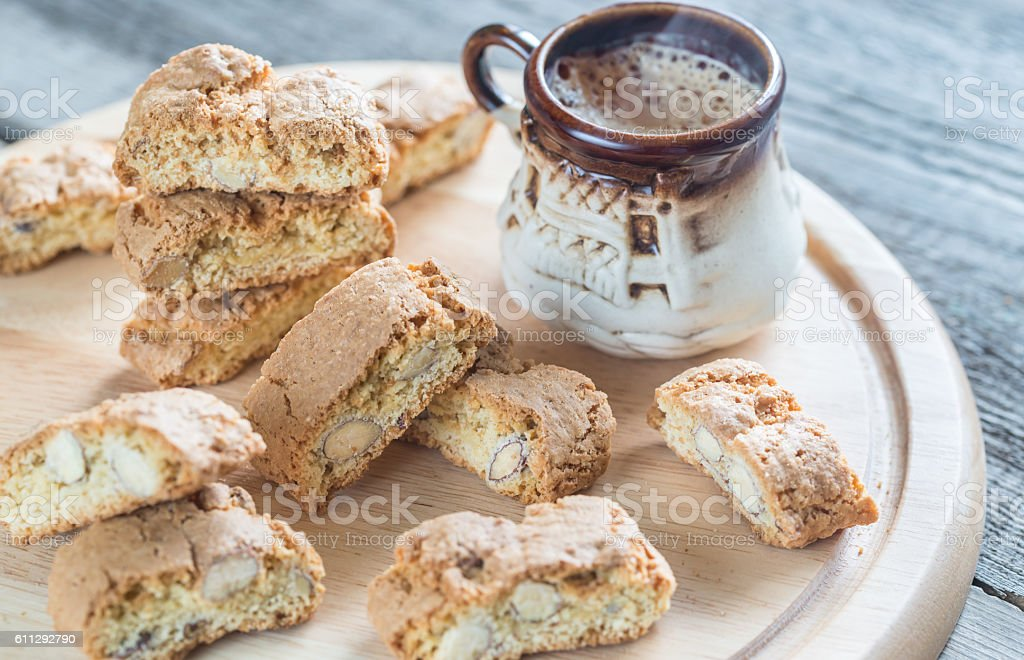Cantuccini with almonds and cup of coffee stock photo